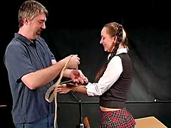 Schoolgirl in braided pigtails bound