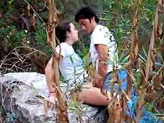 Couple fucks on a rock outdoors