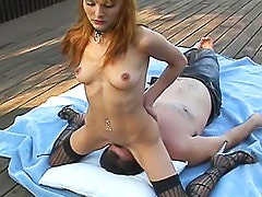 Cute girl rides his face outdoors