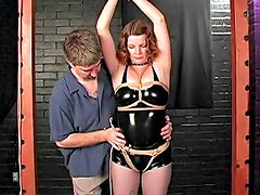 Bound in black latex and spanked