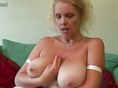 Big titted British mother shows off great rack and