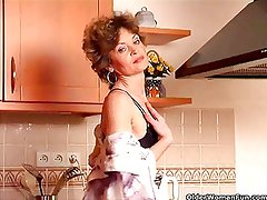 Granny Hannah with small tits gets herself off in kitchen