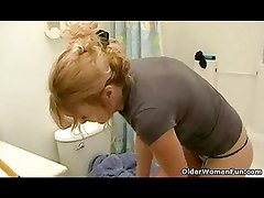 Over 50 granny with suckable tits dildoing in bathroom
