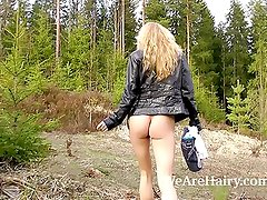 Hairy blonde Lisa T masturbates her hairy pussy outside