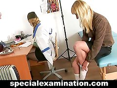 Blonde girl gets examined by doctor