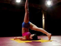 Flexible Wenona shows her acrobatic skills in a ring