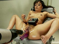 Annie Cruz gets her oiled holes pounded by a fucking machine