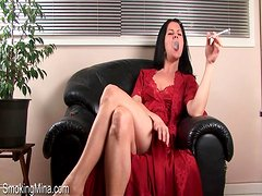 Milf in sexy satin nightgown smokes