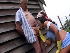 Slutty brunette wearing yellow gloves fucks with an old man