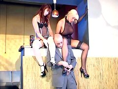 Two bitches in fishnets share a black stud's schlong indoors