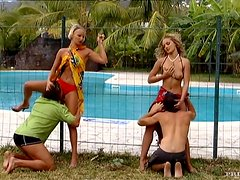 Two hot blondes enjoy foursome banging on the poolside