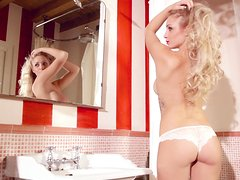 Big tittied Erika Marcato poses in lace lingerie in a bathroom