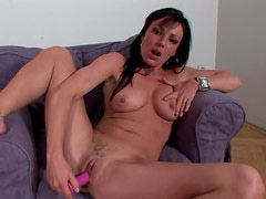 Dark-haired Tina is touching her trimmed puss