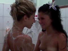 Two soapy babes are playing with their pussies