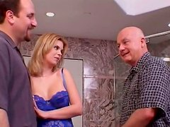 Blonde trollop Kitty Johnson gives a head in the bathroom