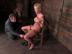 Chubby blond cougar gets tied up on the wooden bar