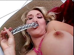 Blonde bimbo works her pussy with glass dildo