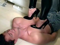 Chick in latex pants tramples him