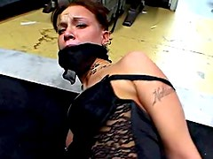 Gagged girl is tied up in the dungeon