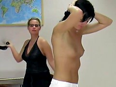 Skirt girl prepares for painful whipping