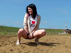 Fetching and hot doll is pissing outdoors