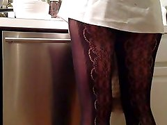 Sexy legs cooking in the kitchen