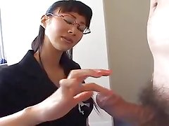 Asian businesswoman gives hot handjob