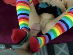 Playful gal wearing funny colorful socks gives toot job
