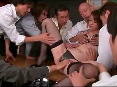 Group of guys fondle Japanese secretary
