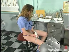 Delightful doctor is using that machine for the stimulation