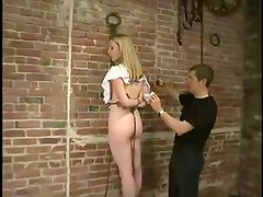 Beautiful blondie is being suspended on the rope net