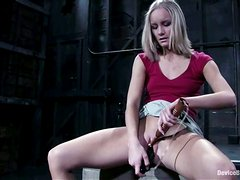 Chained blonde girl hangs out above the floor and gets toyed