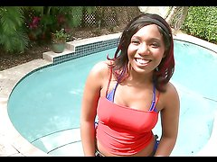 Ebony hottie shows off her great ass before being fucked by the pool