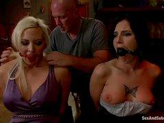 Two sexy girls with nice boobs get bounded and nailed