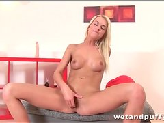 Masturbating blonde squirts hard in pussy play