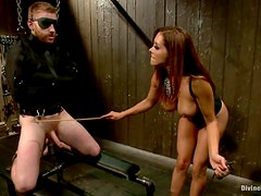 Mistress chains her slave and plays with his hard cock