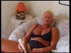 Blonde granny Christine satisfies two men and gets facialed