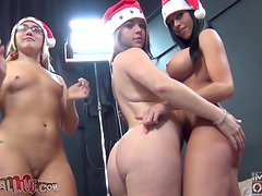 Hot girls in Xmas hats toy each other and ride big cock