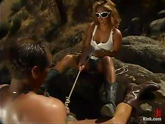 Exotic blond babe is dominating over this man outdoors