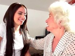 Young woman seduced by sexy granny