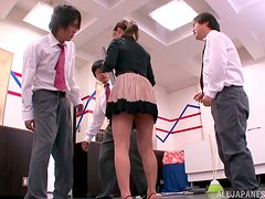 Lovely Mei Asou gives a blowjob to her colleagues in an office