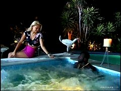 Sunny Blue sucks a black cock and gets her ass smashed in a jacuzzi