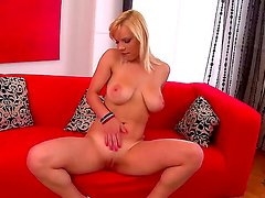 Sensual and hot blonde bombshell Lily enjoys in improving her arousing solo and starts using her