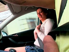 Busty brunette whore gives steamy tug job to a driver