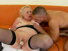 Old woman in black stockings gives her lover a good blowjob