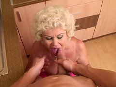 Sex-starved granny gets her pussy fucked in missionary position