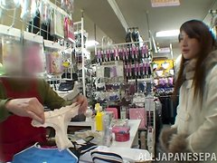 Exquisite Saki Kobashi engulfs a cock in a clothing store.
