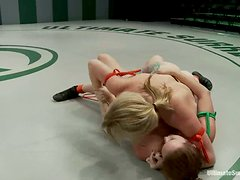 Adrianna Nicole and Bella Rossi play with a strapon instead of wrestling