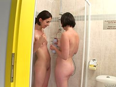 Two girlfriends are showing together in a hot lesbian sex