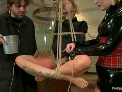 Busty blonde Rain DeGrey gets tormented in a basement and likes it